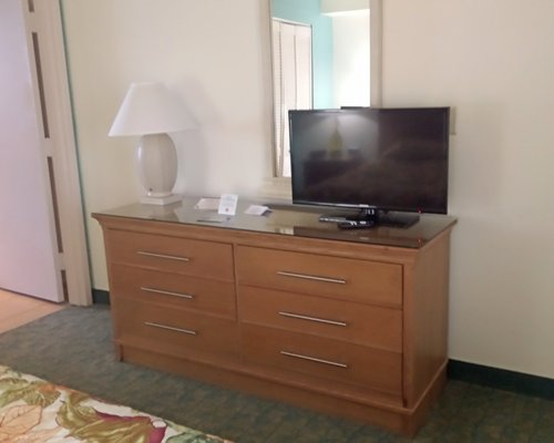 A well furnished room with a television.