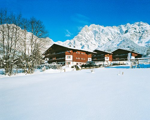 Exterior view of Marco Polo Club Alpina during winter.