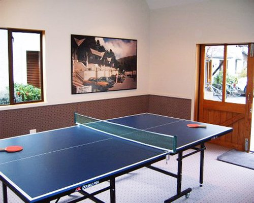 An indoor recreation room with ping pong.