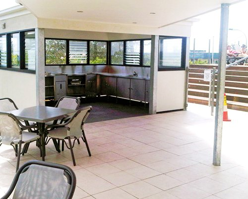 An open plan kitchen with outdoor dining area.