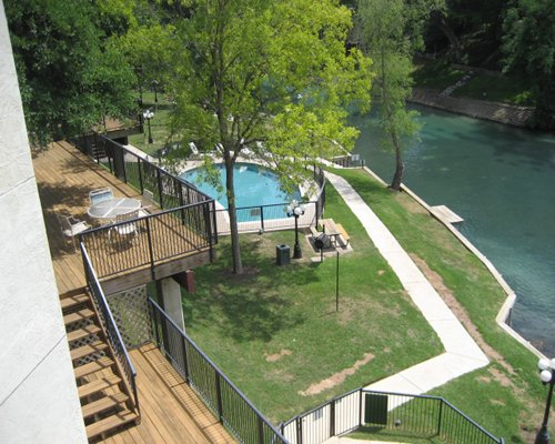 Balcony view of an outdoor swimming pool.