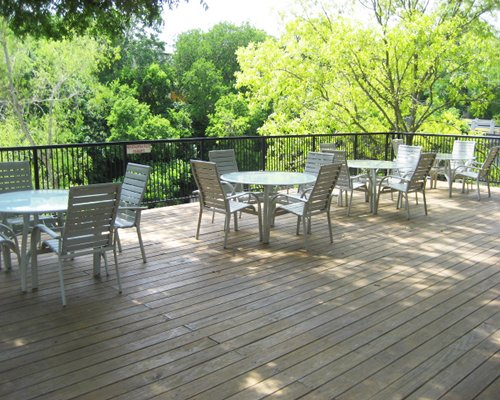 Balcony with patio furniture and view of wooded area.