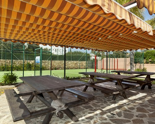 An outdoor picnic area alongside the outdoor basketball court.