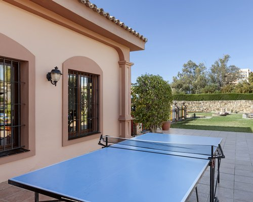 Outdoor recreation area with ping pong table.