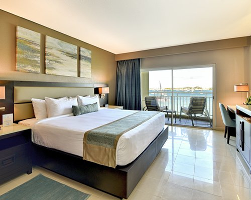 A bathroom with a stand up shower sink and vanity.