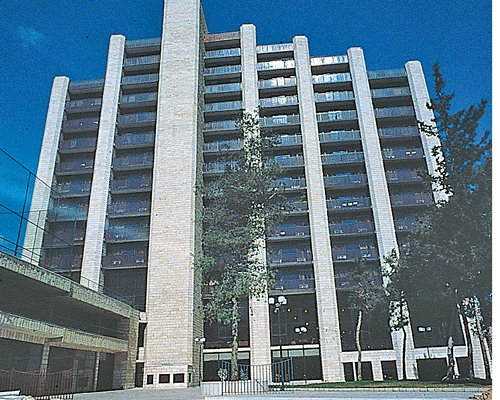 Exterior view of Jerusalem Gardens  Hotel and Spa with multiple balconies.