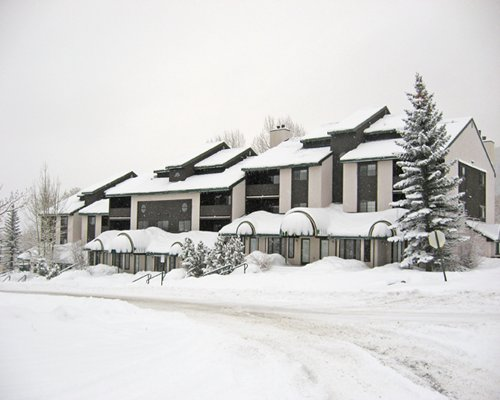 Exterior view of the resort unit covered by snow.