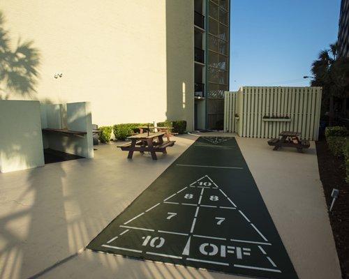 Outdoor shuffle board alongside a unit.