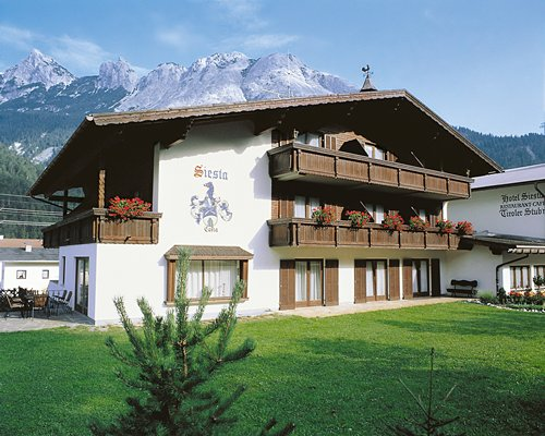 Scenic exterior view of Siesta Ferienclub Scharnitz  Mondi resort alongside the mountain.