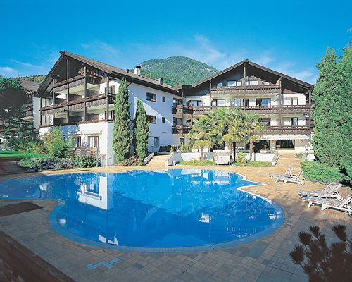 Exterior view of the resort with outdoor swimming pool.
