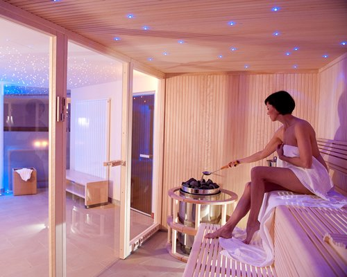 A woman in the well furnished spa room.