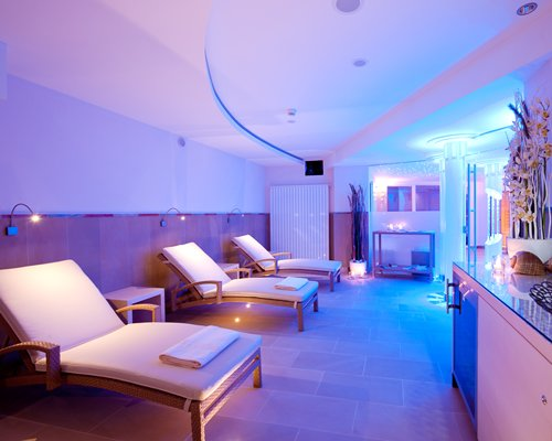 Reception at Spa with chaise lounge chairs and neon lights.