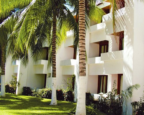 Scenic exterior view of multiple unit balconies at Ixtapa Palace Resort.