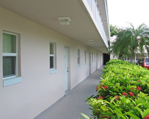 A corridor view of the resort alongside the parking lot.