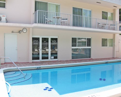 Exterior view of a unit with balcony and outdoor swimming pool.
