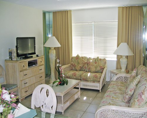 A well furnished open plan living room and dining area with a television.