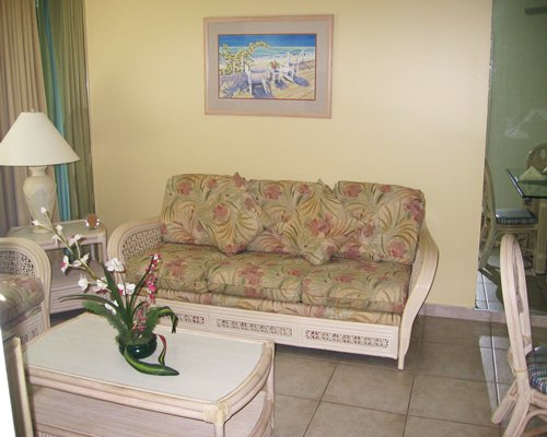 A well furnished open plan living room and dining area.