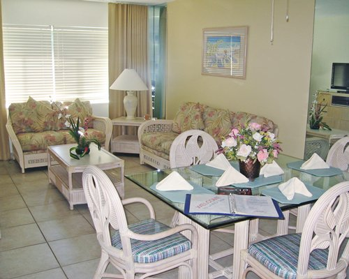 A well furnished living room and dining table.