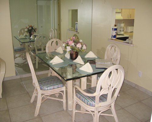 A well furnished glass topped dining area.