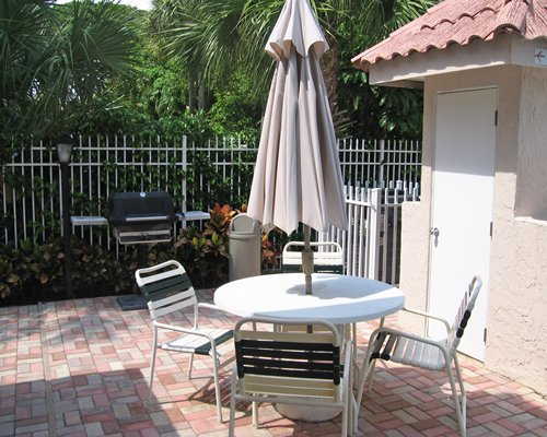 An outdoor dining area with barbecue grill.