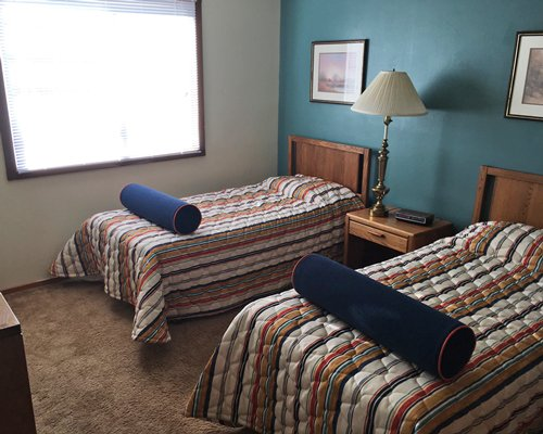 A well furnished bedroom with twin beds.
