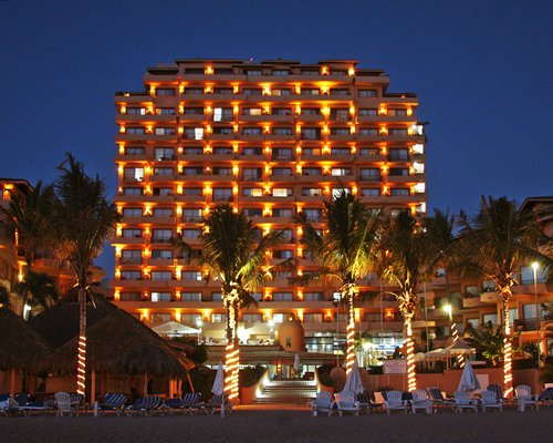 An exterior view of Hotel Hola Puerto Vallarta Club & Spa resort at night.