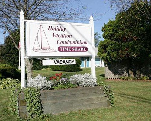 Signboard of Holiday Vacation Condominiums.