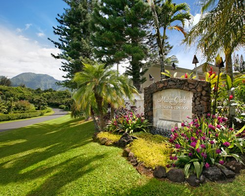 A signboard of the Makai Club Cottages resort.