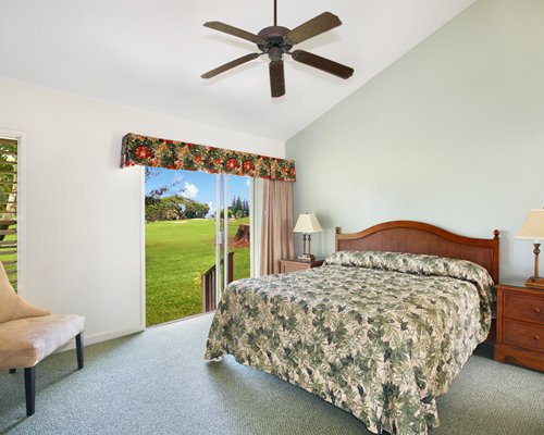 A well furnished bedroom with a multiple king bed and a patio.