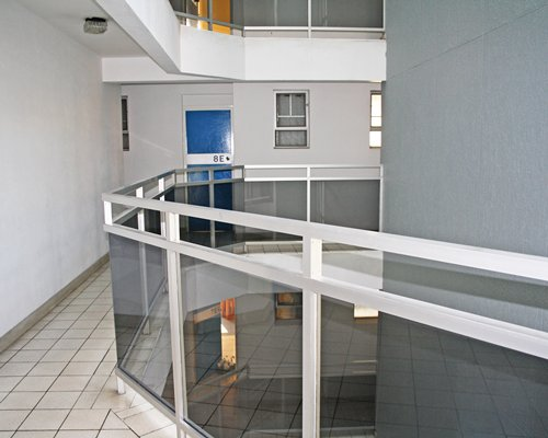An indoor balcony of a multi story resort unit.