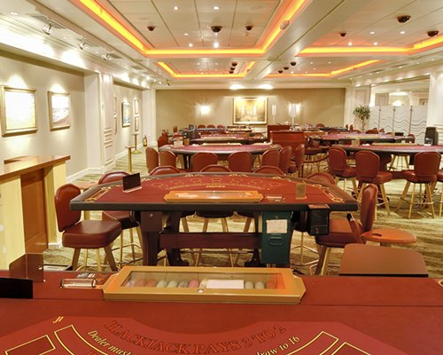Indoor recreation room with casino tables.