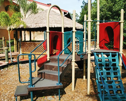 An outdoor kids playscape alongside resort unit.