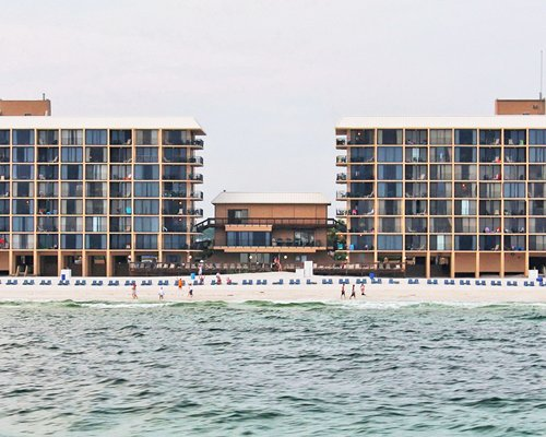 A view of the Ocean Towers Beach Club alongside the waterfront.