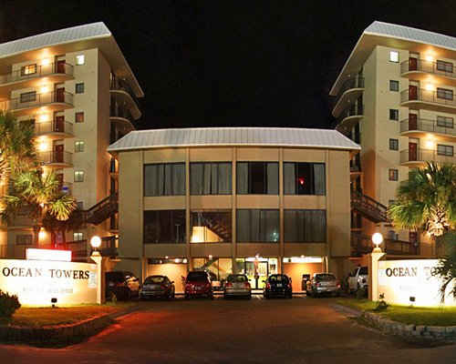 Exterior view of Ocean Towers Beach Club resort at night.