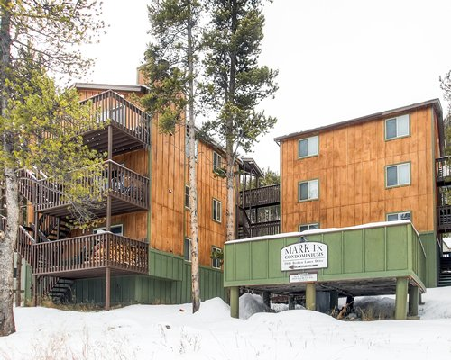 Exterior view of Mark IX Condominiums with multiple balconies during winter.