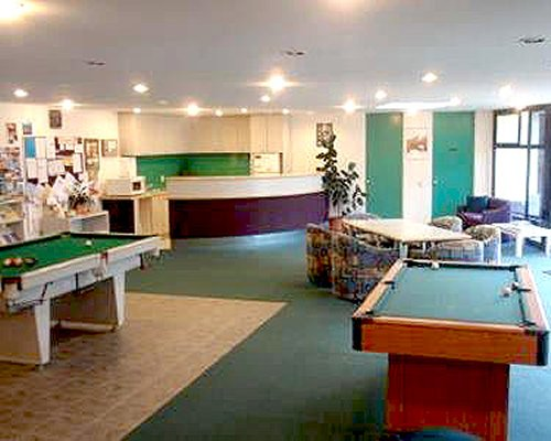 An indoor recreation room with pool tables.