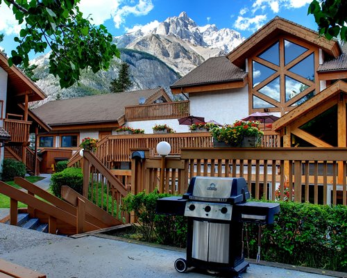 A scenic view of a barbeque grill alongside the multiple units.