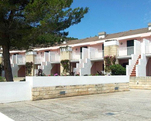 Scenic exterior view of multiple units with balconies at Residence I Delfini Di Pugnochiuso.