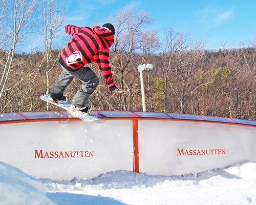 A boy snowboarding at Massanutten's Shenandoah Villas.