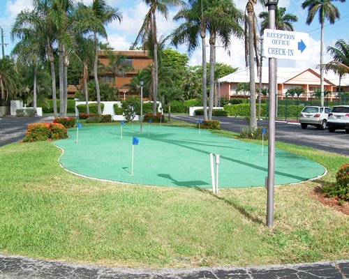 An outdoor golf miniature alongside the parking lot.