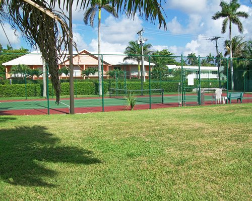 Scenic view of an outdoor tennis court alongside the resort unit.