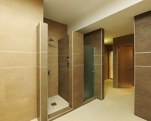 A bathroom with shower stalls.
