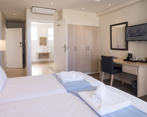 A well furnished bedroom with attached bathroom.