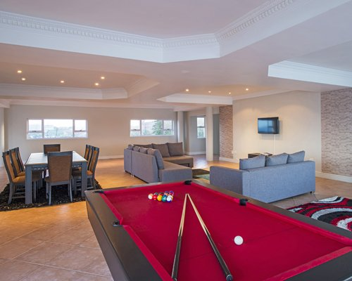 Indoor recreational room with pool table.