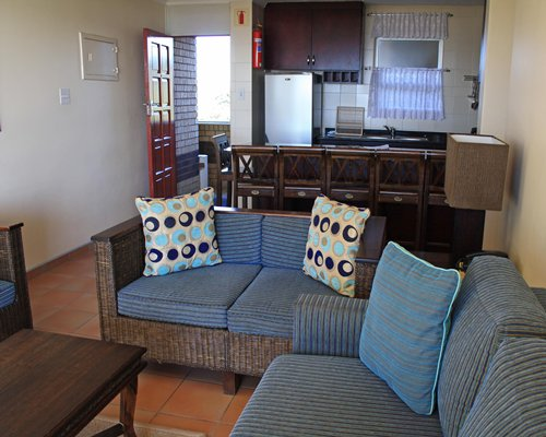 A well furnished living room with a kitchen.