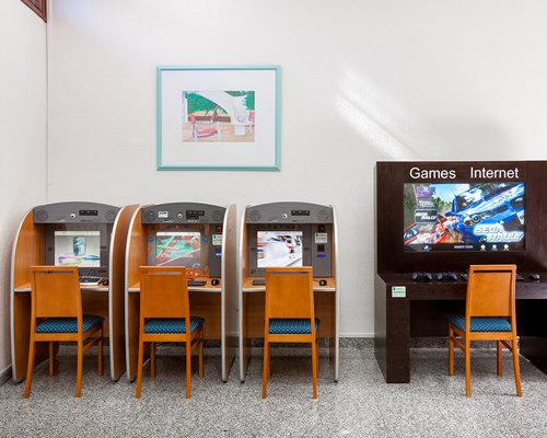 Indoor recreation room with arcade games.