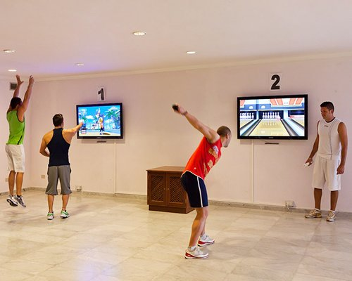 People playing virtual games in the indoor recreational room.