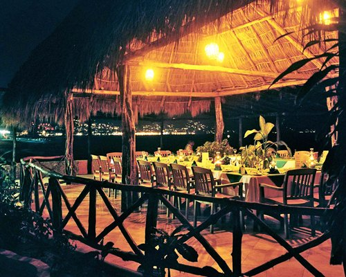 A restaurant of Hotel Las Palmas Beach Resort at night.