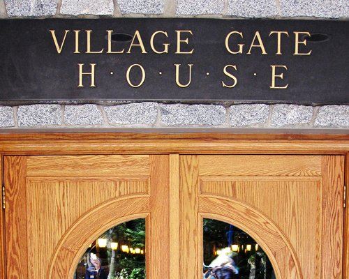 Signboard of Village Gate House resort.