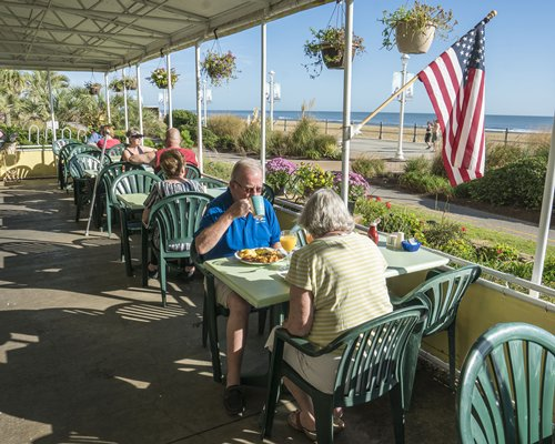 View of people in a restaurant at Four Sails Resort with the ocean view.